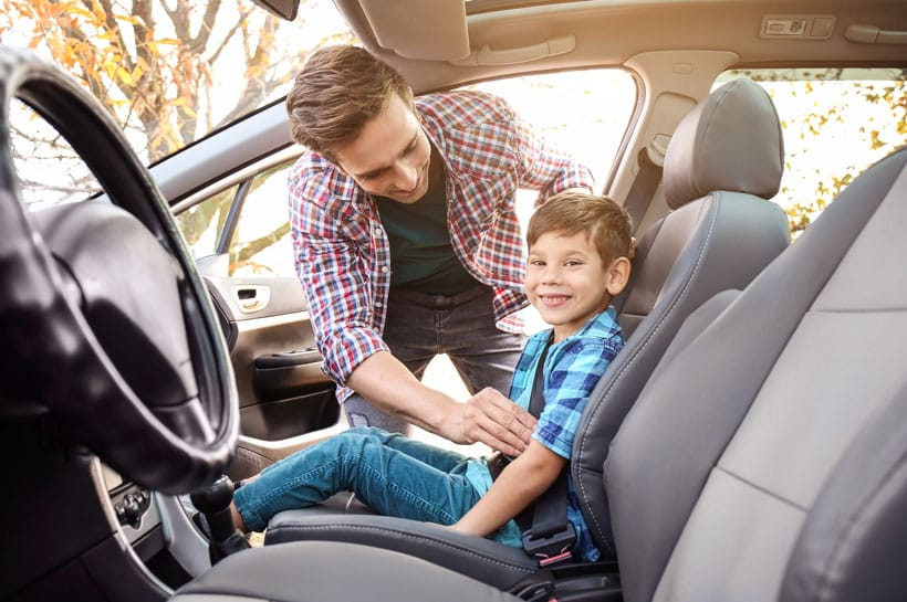 when can a child sit in front seat